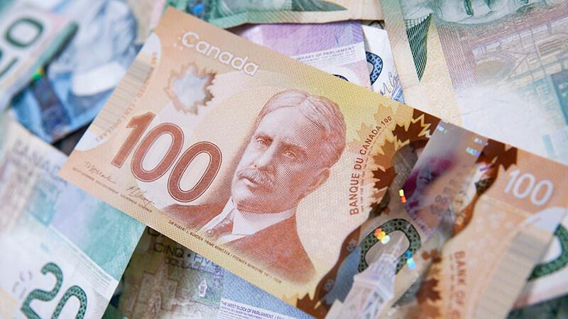 Onde comprar dólares canadenses mais baratos para o Canadá